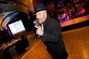 Backdrops-David Patrone Singing at SD MPI Holiday Party